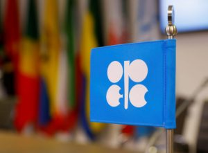 Oil climbs, lifted by U.S.-China trade deal hopes, OPEC cuts